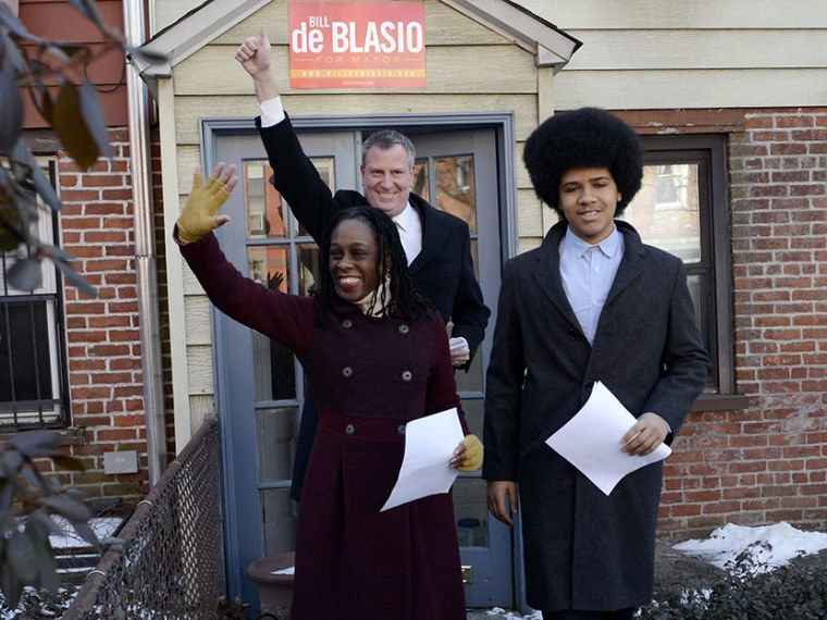 New York City Public Advocate Bill de Blasio (C) waves to supporters with his wife Chirlane McCray (L) and son Dante as they leave their house to announce his Democratic candidacy for mayor in the Brooklyn borough of New York, January 27, 2013. (Photo...