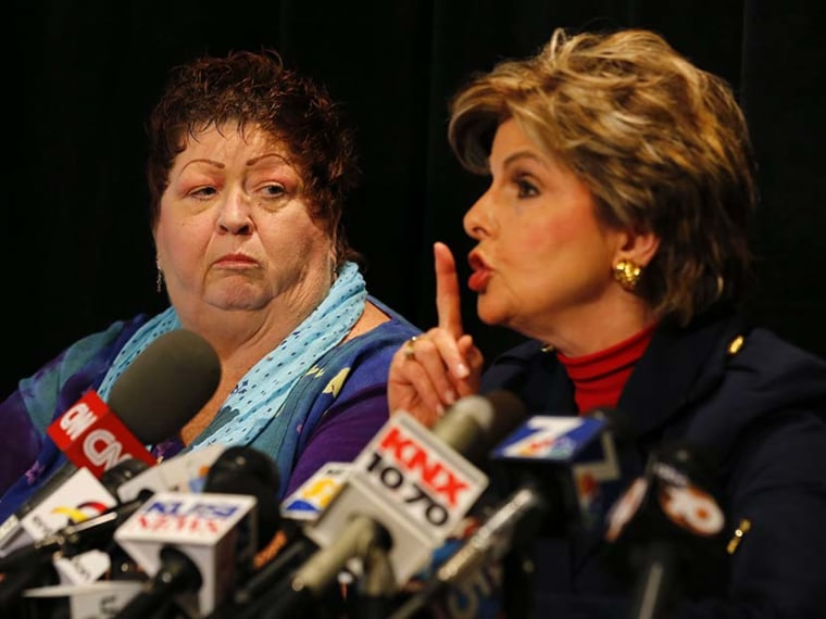 Great-grandmother and senior citizen Peggy Shannon, who works at the Senior Citizens Service Desk in San Diego City Hall, looks on as her attorney Gloria Allred mimics a gesture Mayor Bob Filner previously made towards her during a news conference in...