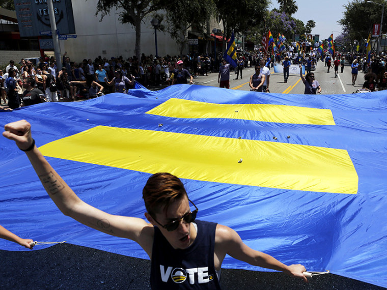 Supporters of equality march during the 43rd annual L.A. LGBT Pride Parade in West Hollywood June 9, 2013. (Photo by Patrick T. Fallon/Reuters)