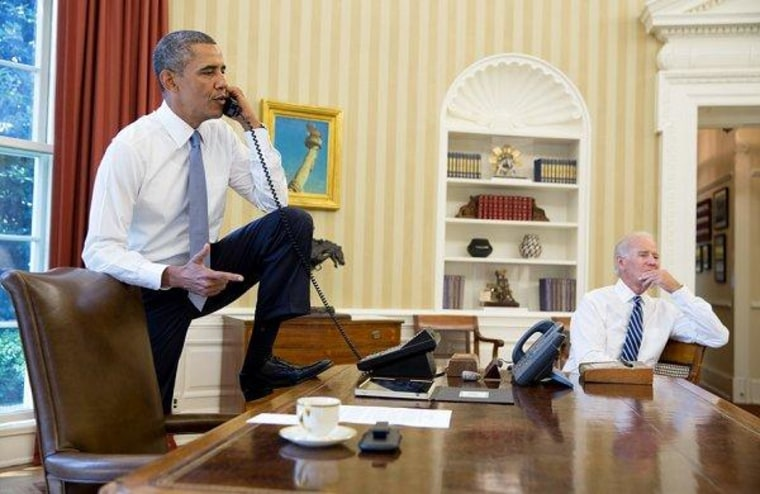 President Obama talks on the phone in the Oval Office with House Speaker Boehner earlier today.