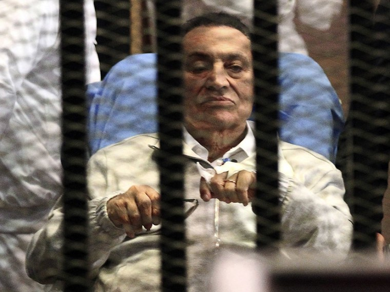 Image: File picture shows Egypt's ousted President Mubarak sitting inside a dock at the police academy on the outskirts of Cairo