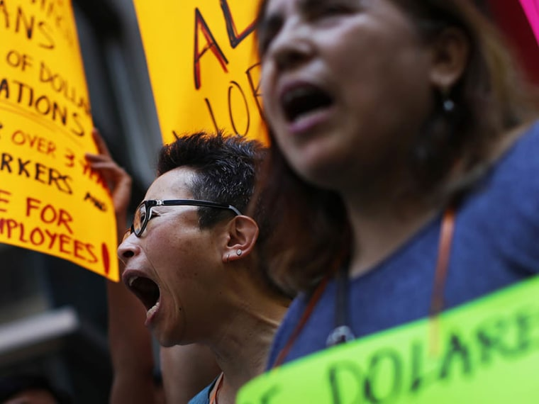 Low wage workers take part in a protest organized by the Coalition for a Real Minimum Wage outside the offices of New York Governor Andrew Cuomo,