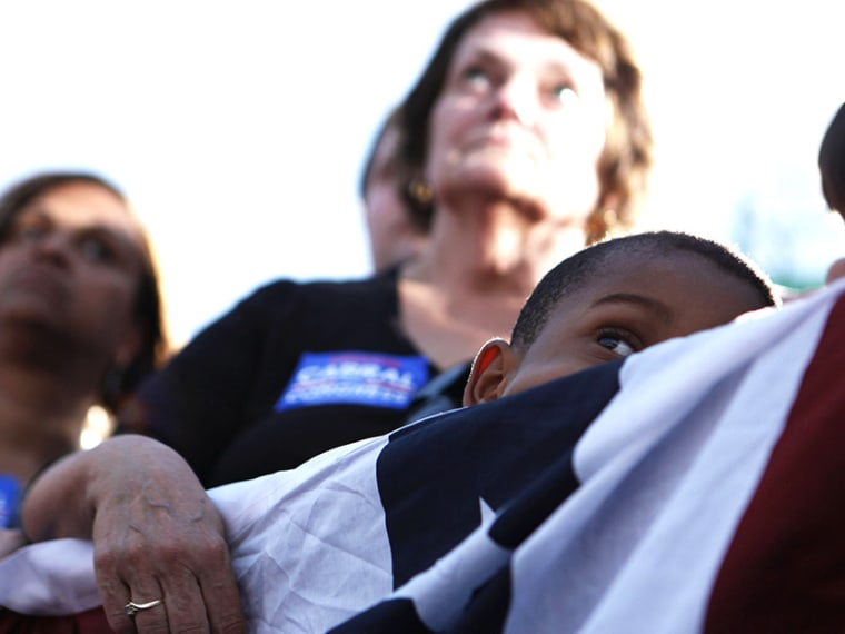 Supporters listen to U.S. President Obama speaking at a campaign event at Loudoun County High School in Leesburg