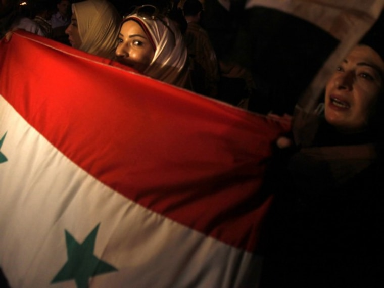 Syrians protesters living in Egypt take part in a demonstration in front of the Arab League headquarters in Cairo
