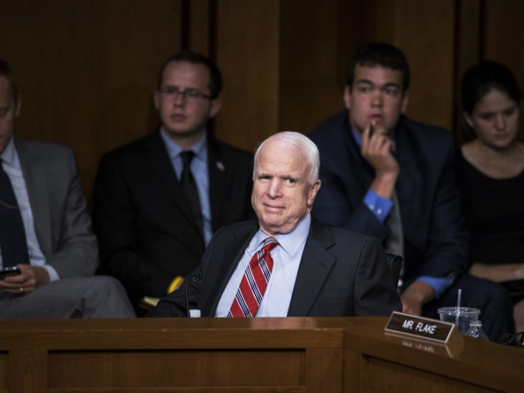 John McCain listens during Syria hearing - Ali vitali - 09/3/2013