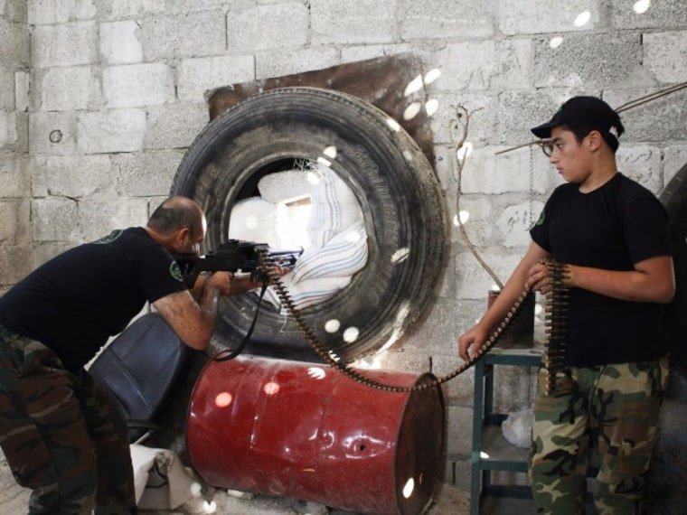 A Free Syrian Army fighter points weapon - Abby Borowitz - 09/3/2013