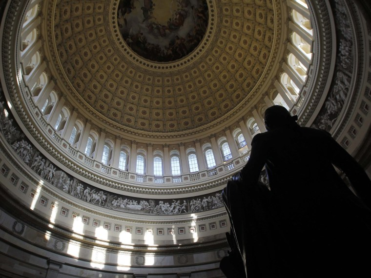 Image: A statue of the United States first President, George Washington, is seen under the Capitol dome in Washington