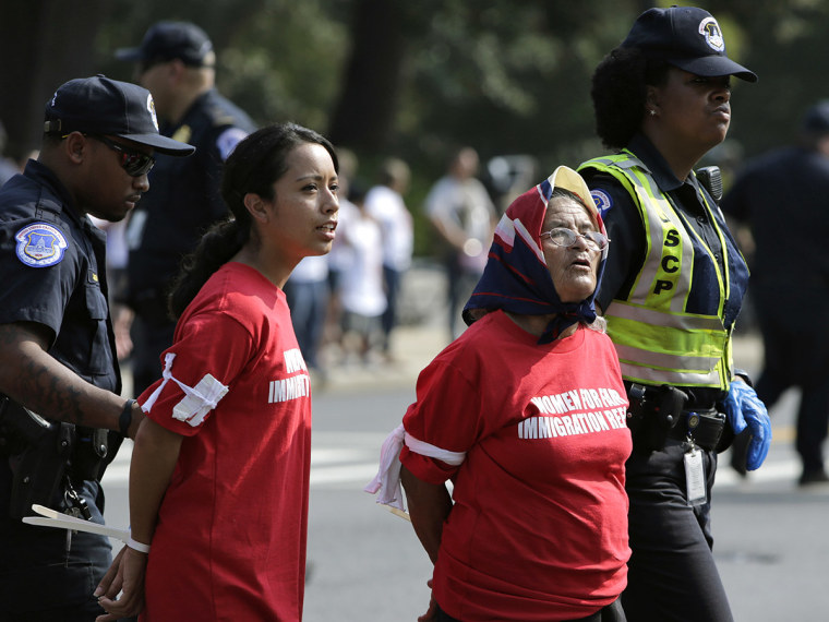 Women demanding fair immigration reform are arrested by police for blocking Independence Avenue