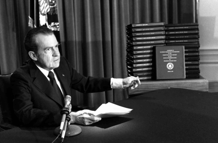 Image:President Richard Nixon gestures toward transcripts of White House tapes after announcing he would turn them over to House impeachment investigators and make them public in April of 1974