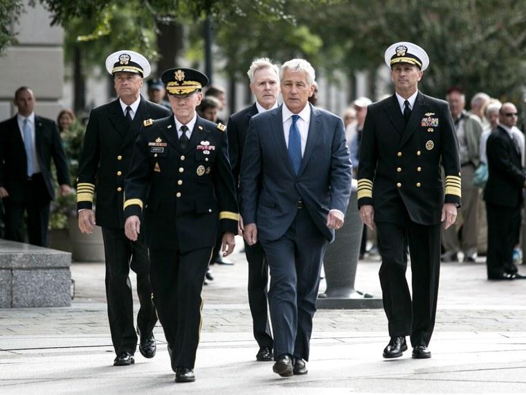 Defense Secretary Chuck Hagel Lays Wreath For Navy Yard Shooting Victims