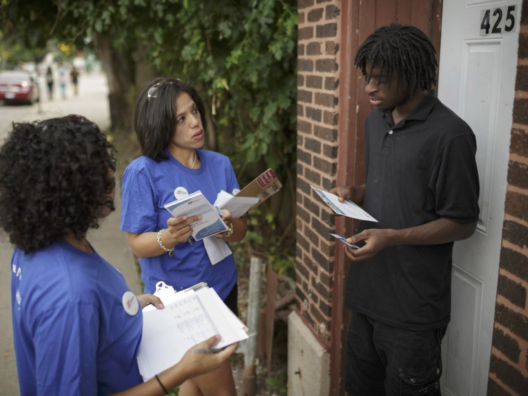 Get Covered America volunteers Cynae Derose and Jalisa Hinkle talk with Daniel Glover about the Affordable Care Act - also known as Obamacare - while canvassing a Chicago neighborhood