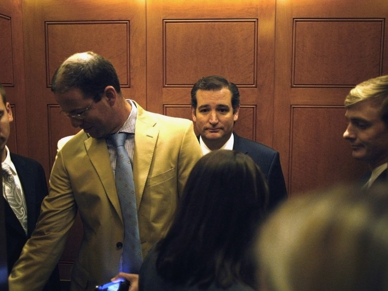 U.S. Senator Cruz departs in an elevator after speaking to reporters about his opposition after the Senate passed a spending bill to avoid a government shutdown at the U.S. Capitol in Washington