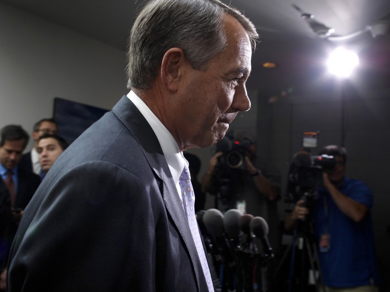 Boehner departs after a closed-door meeting of the House Republican caucus during a rare Saturday session at the U.S. Capitol in Washington