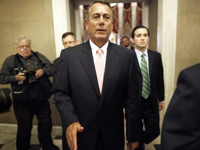 U.S. House Speaker John Boehner returns to his office at the U.S. Capitol in Washington, after the Republican-led U.S. House of Representatives approved another emergency funding bill