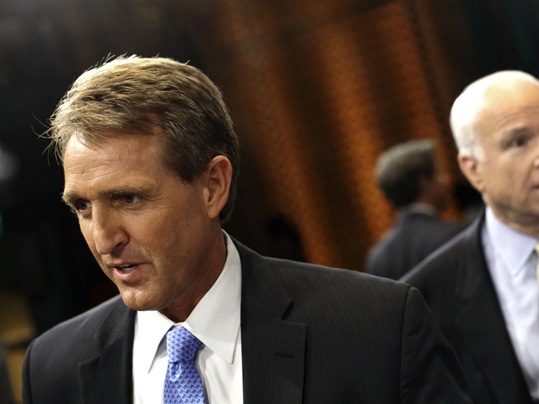 "U.S. Senator Jeff Flake (R-AZ) (L) and U.S. Senator John McCain (R-AZ) speak to reporters after attending a ""Conversation On Immigration"" during a town hall event in Mesa"