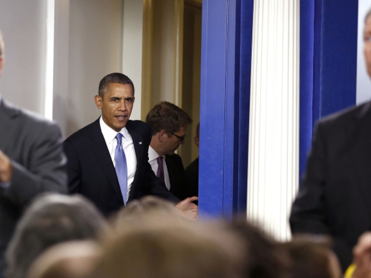 U.S. President Barack Obama walks out before he makes a statement to the media about the government shutdown in the briefing room of the White House in Washington