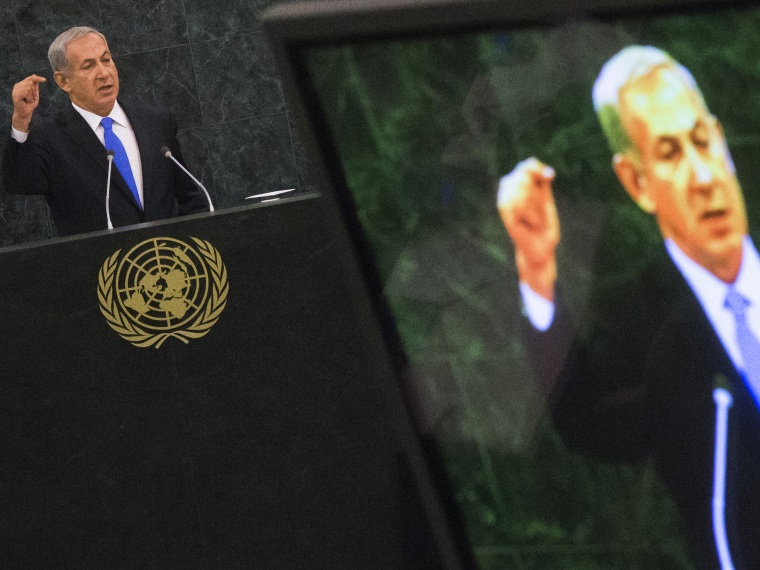 Israel's PM Netanyahu is pictured on a television monitor while addressing the United Nations General Assembly in New York