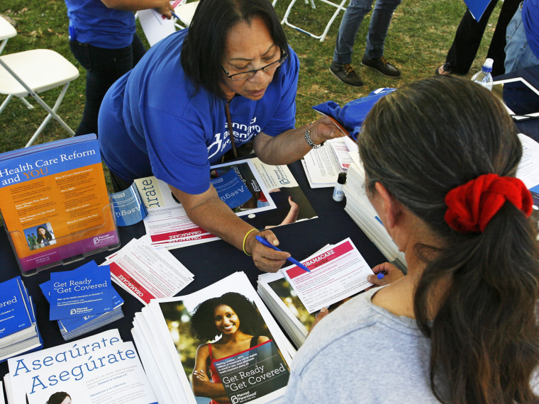 Planned Parenthood worker speaks with a woman during a Planned Parenthood Affordable Care Act outreach event