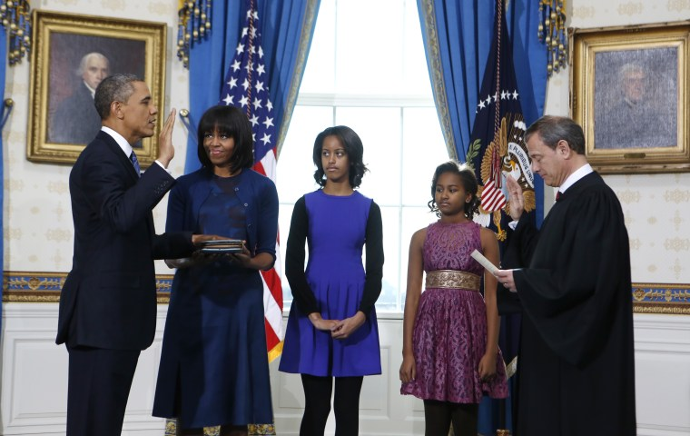 President Barack Obama is officially sworn-in by Chief Justice John Roberts in the Blue Room of the White House during the 57th Presidential Inauguration in...