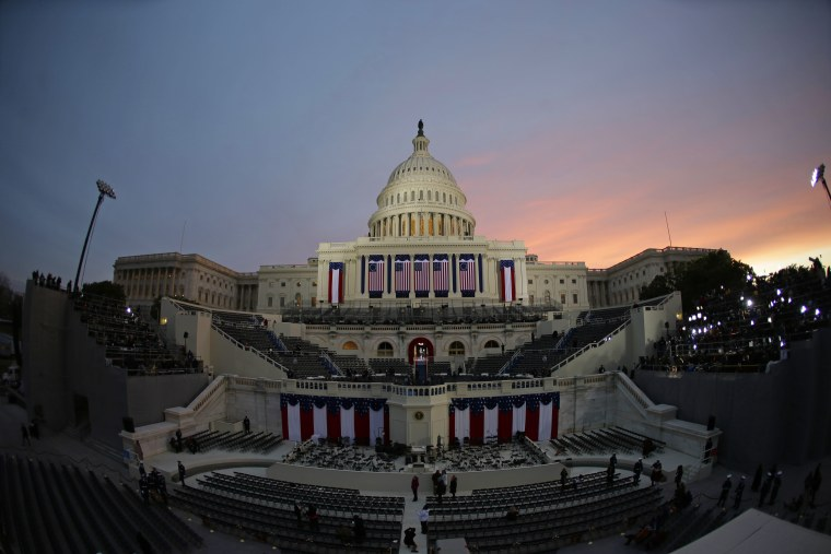 The sun rises behind the Capitol Dome early in the morning before the ceremonial swearing-in of President Barack Obama at the U.S. Capitol during the 57th...