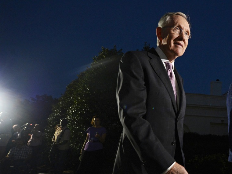 US Senate Majority Leader Harry Reid walks away after delivering remarks to members of the media, October 2, 2013.