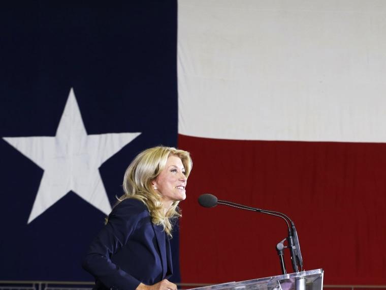 Sen. Wendy Davis speaks to supporter at a rally Thursday, Oct. 3, 2013, in Haltom City, Texas.