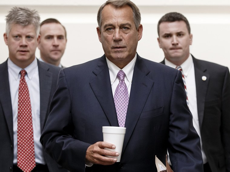House Speaker John Boehner of Ohio walks to a Republican strategy session on Capitol Hill in Washington, Friday, Oct. 4, 2013.