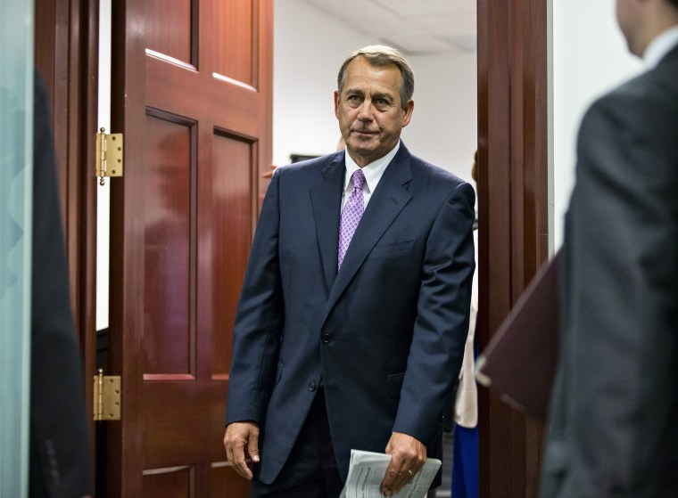 House Speaker John Boehner of Ohio and other members of the Republican Caucus emerge from a closed-door strategy session on Capitol Hill in Washington, Friday, Oct. 4, 2013.