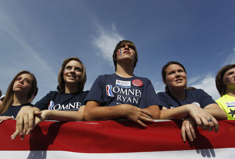 People listen to Republican presidential nominee Romney speak during a campaign rally at Shawnee State University in Portsmouth, Ohio