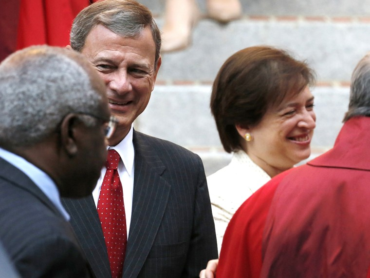 U.S. Supreme Court Justice Clarence Thomas (back to camera), Chief Justice John Roberts and Justice Elena Kagan