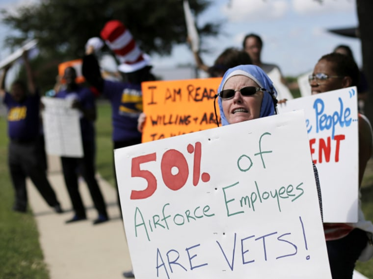Protesters for federal workers idled by the government shutdown gather outside the San Antonio office of U.S. Sen. Ted Cruz, R-Texas, Thursday, Oct. 3, 2013.