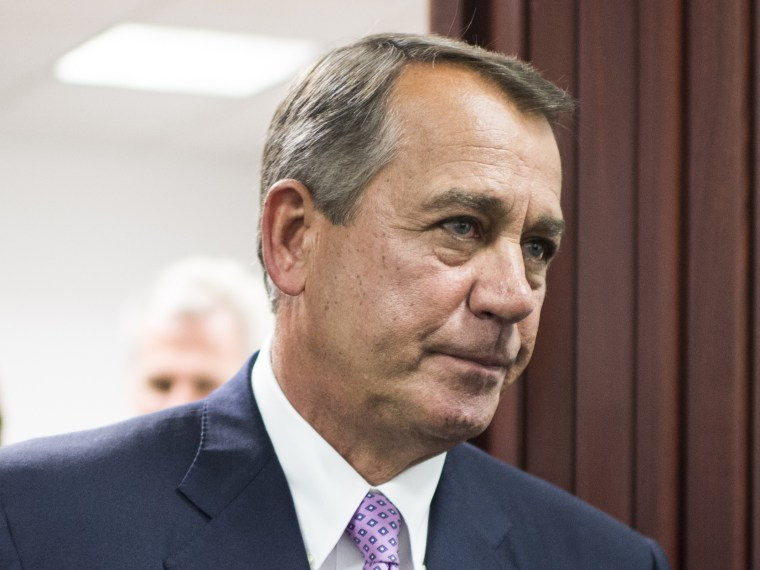 Speaker of the House John Boehner leaves the House Republican Conference meeting in the basement of the Capitol to speak to the media on Friday, Oct. 4, 2013.