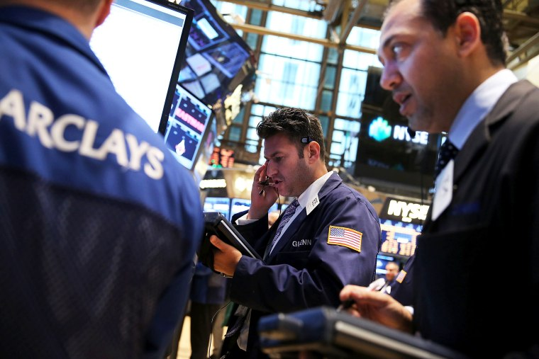 Traders work on the floor of the New York Stock Exchange on October 7, 2013 in New York City.