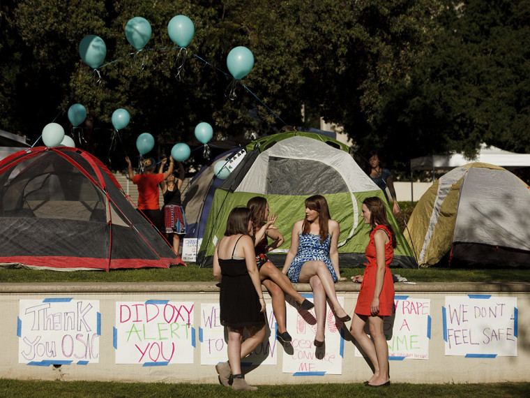 Carly Mee, a student at Occidental College, center, talks with other students during the Oxy Sexual Assault Coalition (OSAC) sexual assault awareness night campout at the college campus in Los Angeles, California, U.S., on Friday, April 19, 2013.