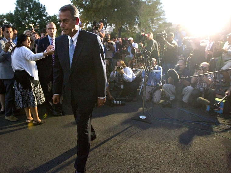 U.S. House Speaker Boehner leaves after a meeting with U.S. President Obama, outside the West Wing of the White House in Washington
