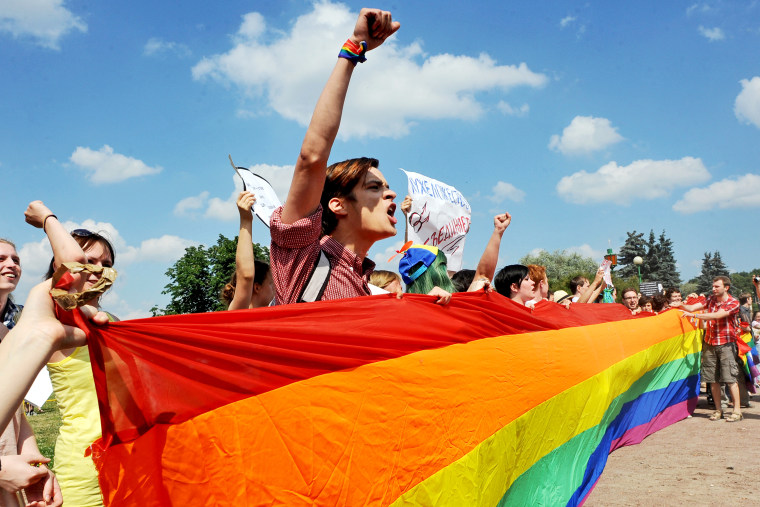 Gay rights activists take part in a gay pride event in Saint Petersburg on June 29, 2013.