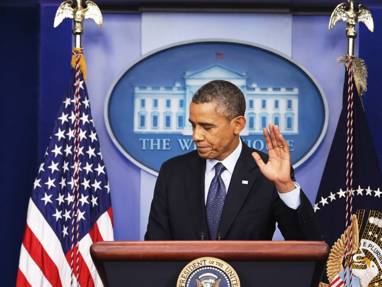 President Barack Obama waves at the conclusion of a press conference in the Brady Press Briefing Room of the White House on October 8, 2013 in Washington, DC.