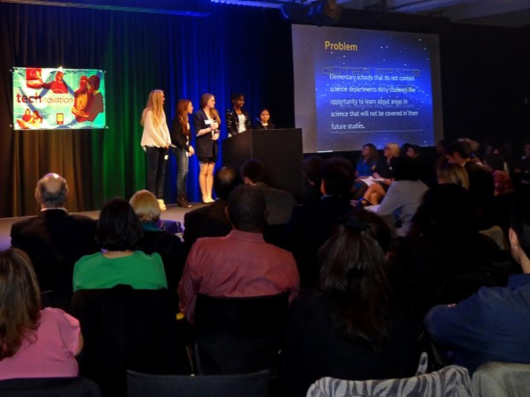 A team of girls presents a cell phone application at Technovation Pitch Night in New York City in April 2012.