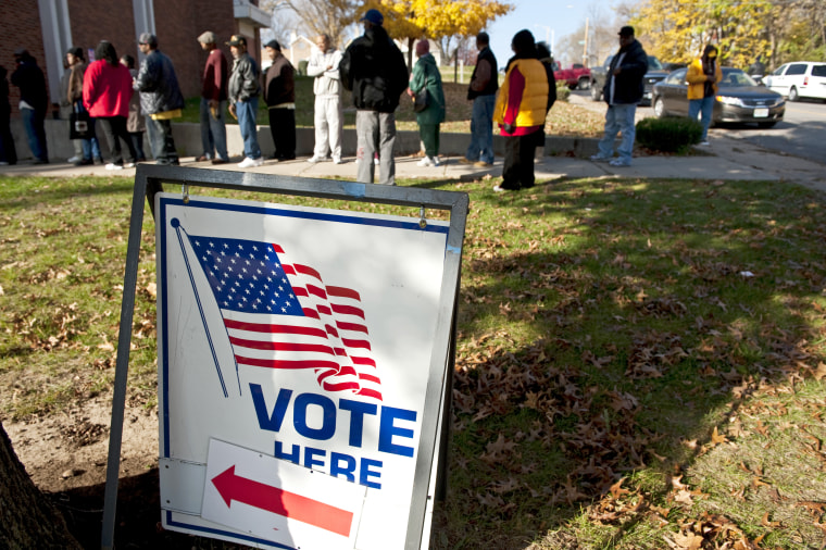Voters wait in line to cast their vote at Mount Pleasant Baptist Church on November 6, 2012 in Kansas City, Missouri.