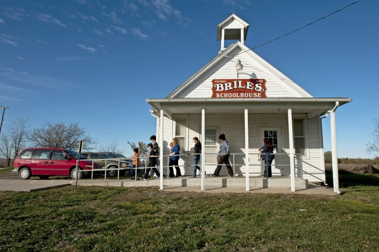 The Eads family leaves after watching their mother Suzie Eads vote at Briles Schoolhouse on November 5, 2012 in Wellsville, Kansas.