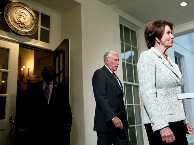 House Minority Leader Nancy Pelosi (D-CA) (R) leaves the White House with Rep. Steny Hoyer (D-MD) following a meeting between U.S. Presiden Barack Obama and members of the House Democratic leadership October 9, 2013 in Washington, DC.