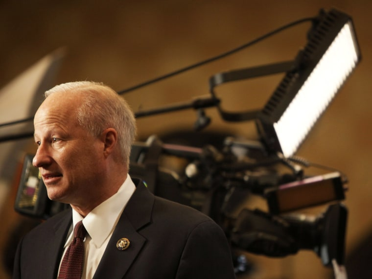 Rep. Mike Coffman, R-Colo., arrives early to talk with reporters during the Colorado Republican election night party at the Doubletree Hotel in Greenwood Village, Colo., Nov. 2, 2010.