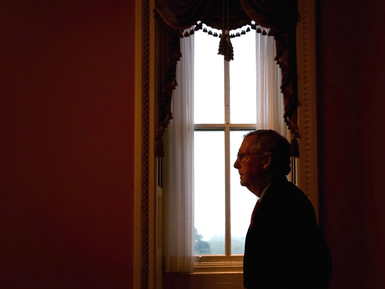 U.S. Minority Leader Senator Mitch McConnell (R-KY) returns to his office after he spoke in the Senate Chamber on Oct. 7, 2013