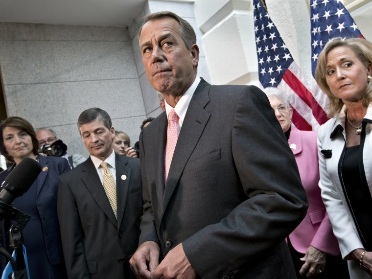 Speaker of the House John Boehner, R-Ohio, joined by fellow Republicans, emerges from a closed-door GOP meeting