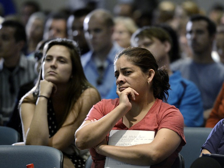 Town hall attendees during a community forum on the Affordable Care Act hosted by Senators Diane Feinstein and Barbara Boxer in Long Beach California