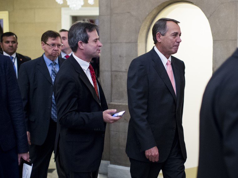 Speaker of the House John Boehner, R-Ohio, walks back to his office after a vote on the House floor in the Capitol on Thursday, Oct. 10, 2013.