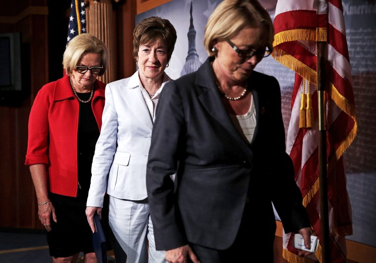 U.S. Sen. Claire McCaskill, Sen. Susan Collins, and Rep. Niki Tsongas leave after a news conference on Capitol Hill in Washington, May 23, 2013.