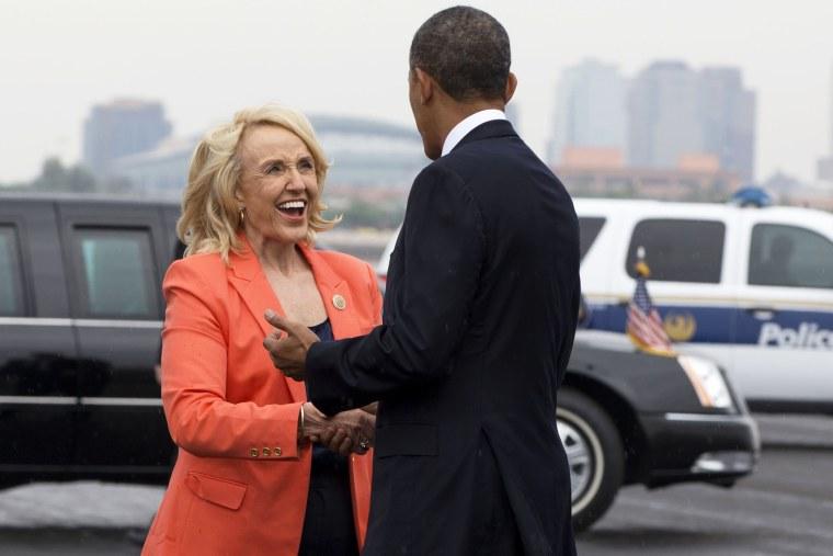 Arizona Gov. Jan Brewer greets President Barack Obama on his arrival in Phoenix, Tuesday, Aug. 6, 2013.