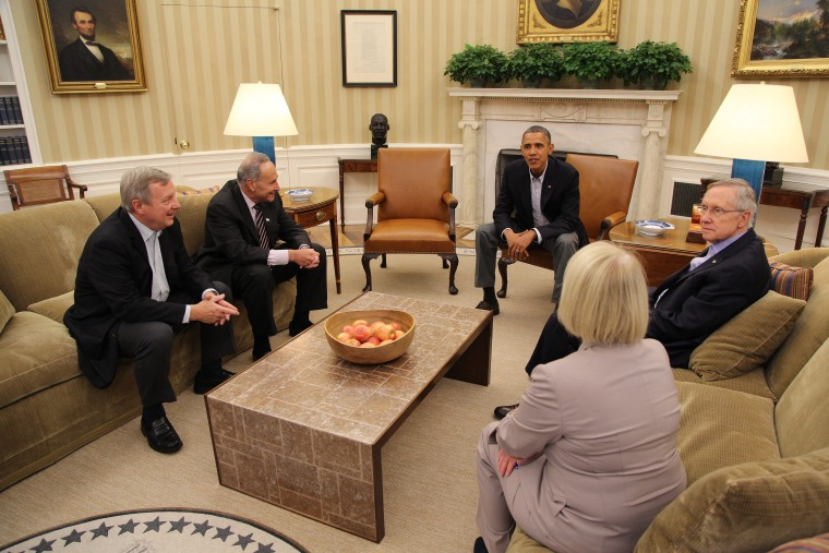 US President Barack Obama (C) meets with Senate Democratic leaders (L-R) Dick Durbin, Chuck Shumer, Harry Reid and Patty Murray, in the Oval Office in Washington DC on Oct. 12, 2013.