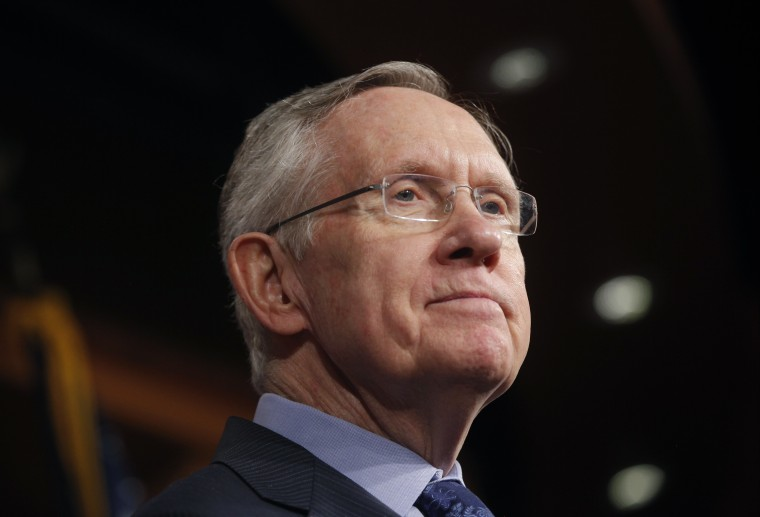 Senate Majority Leader Harry Reid of Nevada, listens to a reporter's question about their meeting with Senate Republicans regarding the government shutdown and debt ceiling on Capitol Hill in Washington on Saturday, Oct. 12, 2013.
